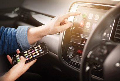 Your phone goes with you Every Outlander has Smartphone Link Display Audio. Using Apple Carplay or Android Auto, you can play music, make calls, check messages and read maps, which update automatically for you. For safety, there's voice operation. Overseas model shown.