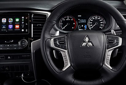 Relax in style After a hard day collapse into the ergonomic seats, which are leather-faced on VRX, and cool down with the dual-zone climate control. Wellside models also feature Smartphone Link Display Audio with Bluetooth®. Every Triton cuts a fine figure with the aggressive new grille.