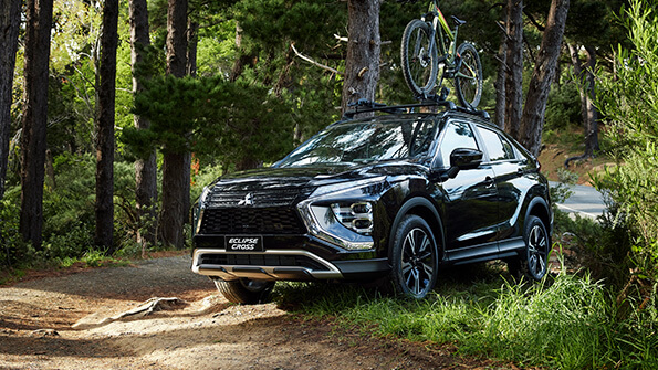 Mitsubishi Eclipse Cross on a trail with roof mounted bike rakes